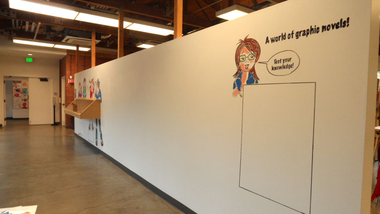 Graphic novel display wall at the Palo Alto Art Center. View from the other side of the wall